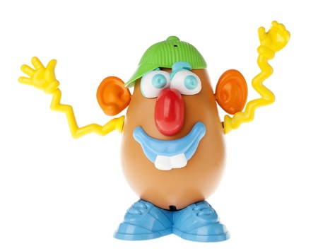 Tel-Aviv, Israel - January 25th, 2012: Isolated on white studio shot of the famous toy Mr. Potato Head, by the Hasbro company. This time, the colorful and extrovert characterisitcs of his components (cap to the side, sideways glance, squiggly yellow hands