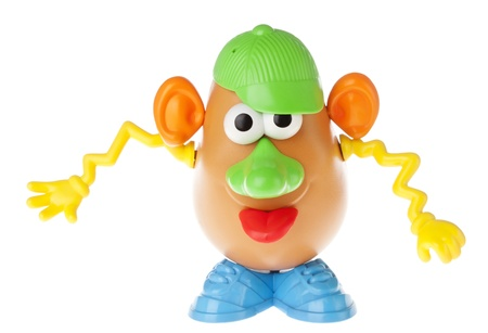 extrovert: Tel-Aviv, Israel - January 25th, 2012: Isolated on white studio shot of the famous toy Mr. Potato Head, by the Hasbro company. This time, the colorful and extrovert characterisitcs of his components (cap to the side, squiggly yellow hands, big green nose