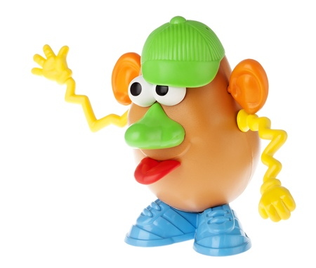 mr: Tel-Aviv, Israel - January 25th, 2012: Isolated on white studio shot of the famous toy Mr. Potato Head, by the Hasbro company. This time, the colorful and extrovert characterisitcs of his components (cap to the side, squiggly yellow hands, big green nose