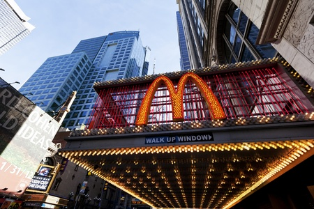 42nd: New-York, USA - November 6th, 2012: Wide angle view of big M sign at the entrance of the McDonalds branch located at 220 W 42nd St. (between 7th and 8th avenues) in Manhattan, with sky scrapers surrounding it. Editorial
