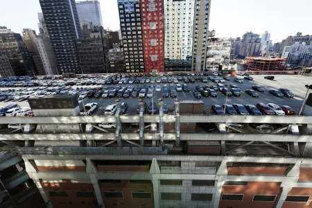 New-York, USA - November 6th, 2012: Wide angle view of the NYC Port Authoritys (central bus station) rooftop parking lot, almost full with cars, and surrounded by midtown skyscrapers.