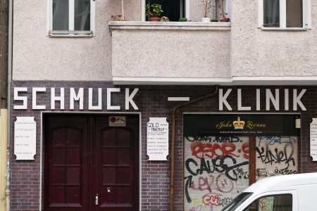 klinik: Berlin, Germany - June 9th, 2012: Sign and entrance to a jewelry store called Schmuck klinik (jewelry clinic), located at Boxhagener street