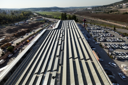 Beit-Shemesh, Israel - December 28th, 2011: High & wide angle view to the north-west at the roof of the Big shopping mall, located at the western industrial park of Beit-Shemesh. The malls roof is completely covered by power-generating solar panels tha