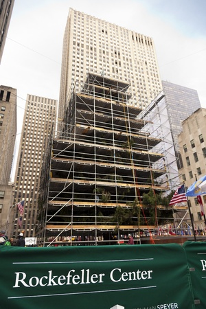 New-York, USA - November 20th, 2012: The traditional Rockefeller Center Christmas tree surrounded by scaffolding, in preperation for the famous Christmas ceremony.