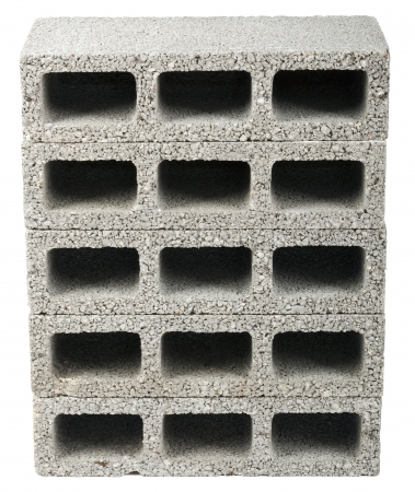 masonary: Five gray concrete construction blocks (a.k.a. cinder block, breeze block, cement block, foundation block, besser block; professional term: Concrete Masonary Unit - CMU) in a straight stack, isolated on white background. Stock Photo