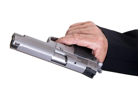 The right hand of a mature adult man wearing a suit, holding a 9mm gun in sideways position, aiming it to the target. Isolated on white background. photo