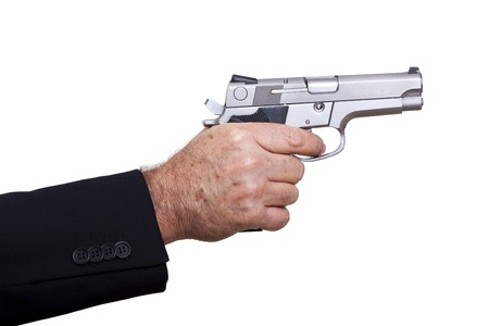 A mature adult man wearing a suit, holding a 9mm gun with his right hand, aiming it to the target. Isolated on white background. photo