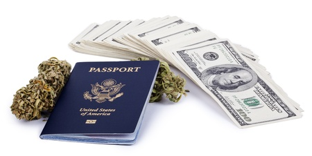 A USA passport, a marijuna bud and a large stack of 100 US dollar money notes isolated on white background. photo