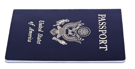 A USA passport Isolated on white background. This is the old version of the passport, before the biometric chip was added (the new passport is featured in some of the following photos). photo