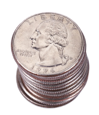 A stack of 25 US cent (quarter) coins isolated on white background. George Washington's portrait is depicted on the coin. photo