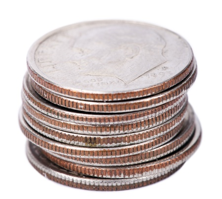dime: A stack of American Dimes (10 cents) isolated on white background. This is the Roosevelt dime, originally issued in 1946. Focus on the front of the stack.