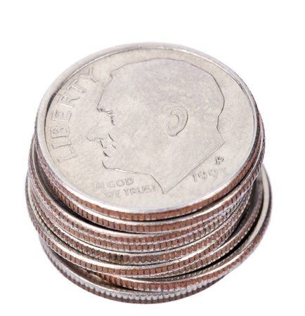 dime: A stack of American Dimes (10 cents) isolated on white background. This is the Roosevelt dime, originally issued in 1946.