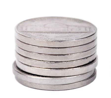 A stack of 5 US cents (Nickel) coins isolated on white background. The reverse side of the coin is seen here, depicting Thomas Jeffersons Virginia estate, Monticello. photo