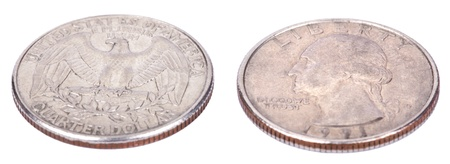 close quarters: Two sides of a USA 25 cent (quarter) coin. The obverse side depicts presidents George Washington profile portrait, and the reverse side depicts USAs coat of arms - the bald eagle. Isolated on white background. Stock Photo