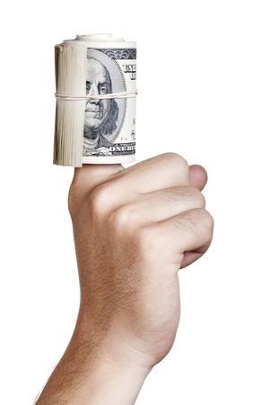 Close up of the right hand of an adult man with a rolled up cluster of 100 US$ money notes wrapped in a rubber band and around his finger. Isolated on white background. photo