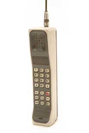 Early 1990s Style Mobile Phone. One of the first models ever made.  Isolated on white background. Stock Photo