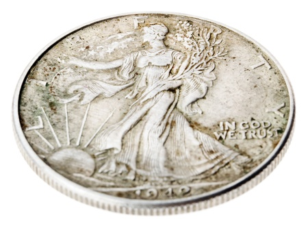 minted: High angle view of the reverse (tails) side of a silver half Dollar minted in 1942.