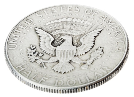 High angle view of the obverse (heads) side of a silver half Dollar minted in 1964.Depicted is the US presidential seal.