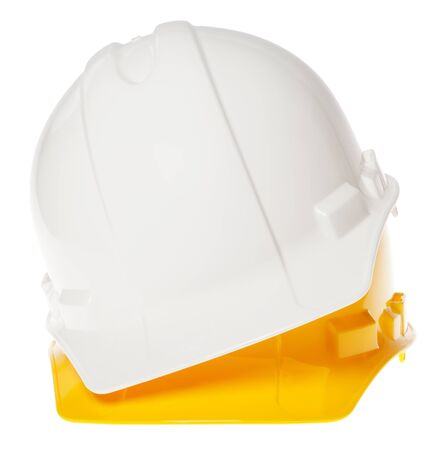Frontal view of two hard hats, white on top of yellow, isolated on white background. photo