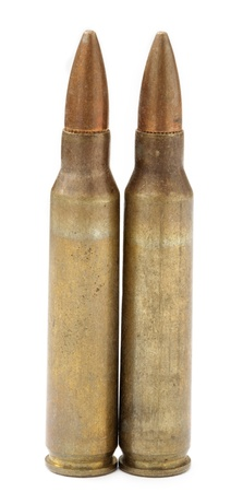 Two isolated 5.56 assault rifle cartridges (for M-16 assault rifle for example). photo