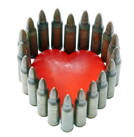 powe: A heart shaped bar of soap completely surrounded by 5.56 cartridges. Shot from a high anlge. Isolated on white background.
