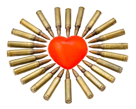 A heart shaped bar of soap is surrounded by 5.56 cartridges pointing at it. Fits the concept of 'Heart Attack'.