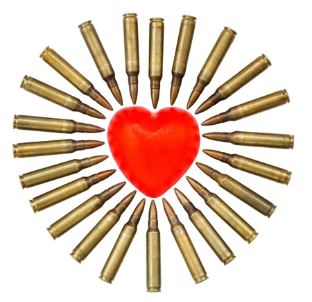 A heart shaped bar of soap is surrounded by 5.56 cartridges pointing at it. Fits the concept of 'Heart Attack'. Isolated on white background Stock Photo - 18925489