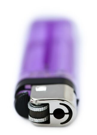Half-transparent simple purple lighter isloated on white background.  photo