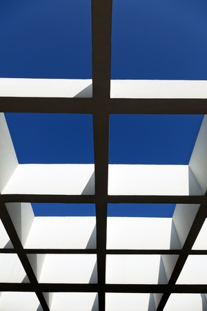 Low angle shot of a patio pergola on the background of lovely clear sky. Stock Photo - 18929850