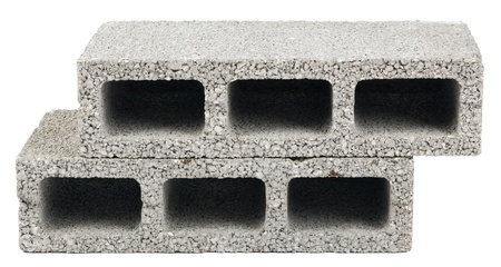 Two gray concrete construction blocks (a.k.a. cinder block, breeze block, cement block, foundation block, besser block; professional term: Concrete Masonary Unit - CMU) in a stack, isolated on white background.