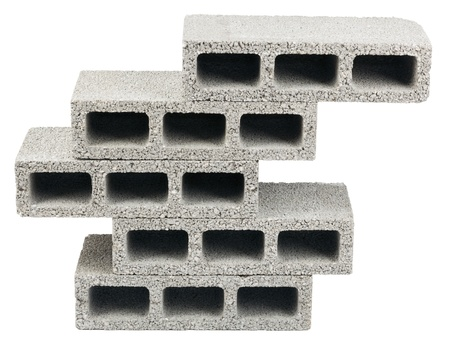 masonary: Five gray concrete construction blocks (a.k.a. cinder block, breeze block, cement block, foundation block, besser block; professional term: Concrete Masonary Unit - CMU) in a stack, isolated on white background.
