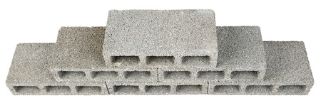 masonary: Six gray concrete construction blocks (a.k.a. cinder block, breeze block, cement block, foundation block, besser block; professional term: Concrete Masonary Unit - CMU) stacked together in the shape of a pyramid. High angle view, Isolated on white backgro