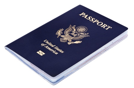A USA passport Isolated on white background. This is the new version of the passport, with the biometric chip (the old version of the passport is featured in some of the following photos). photo