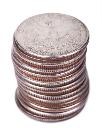 A stack of 25 US cent (quarter) coins isolated on white background. The Bald Eagle, USAs coat of arms is depicted on the coin. photo