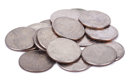 A pile of 25 US cent (quarter) coins isolated on white background. photo