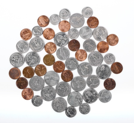 Various American coins (quarters, dimes, nickels, pennies) displayed on white background.  DEAR INSPECTOR: This is NOT an 'isolated on white image'. photo