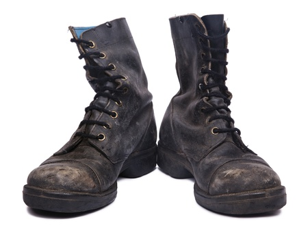 Frontal view of a very worn pair of boots, issued by the Israeli army (IDF). isolated on white background. Stock Photo
