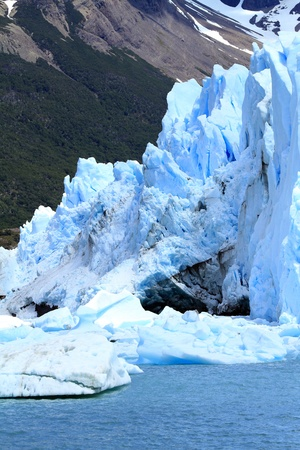 Glacier part infront of a mountain on the water of a lake in Patagonia, South America. Stock Photo - 18977416