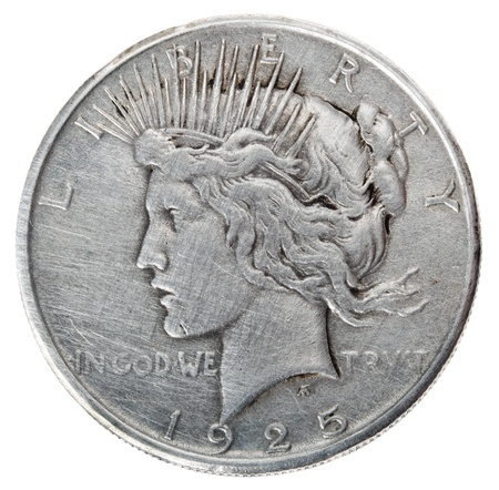 minted: Frontal view of the obverse (heads) side of a silver dollar minted in 1925, known by the name Peace Dollar.