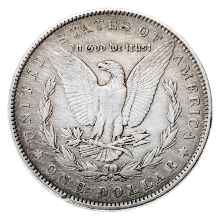 Frontal view of the obverse (heads) side of a silver dollar minted in 1883, known by the name 'Morgan Dollar' (named after its designer). Depicted is an eagle with wings outstretched Isolated on white background. photo