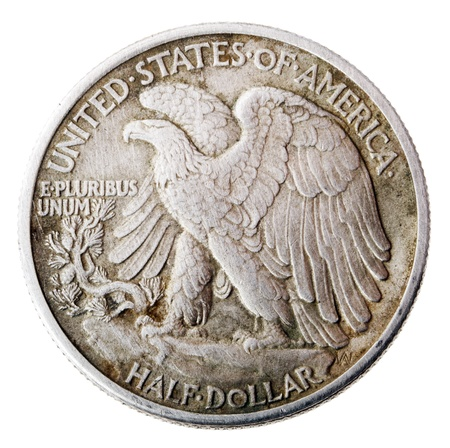 american currency: Frontal view of the reverse (tails) side of a silver half Dollar minted in 1942. Depicted is a bald eagle rising from a mountaintop perch. Isolated on white background.