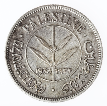 mandate: Reverse (tails) side of a vintage Palestine 50 mils coin, minted in 1933 when the British mandate ruled the land of Israel. Isolated on white background.