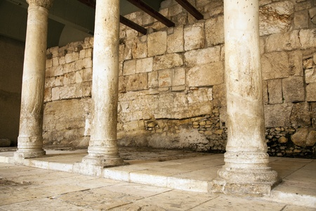jewish quarter: This is one of the main market roads from 2000 years ago, in the old city of Jerusalem in Israel. Archeological excavations had exposed this road and the pillars. It is located in the Jewish quarter, and is a main tourist attraction. Stock Photo