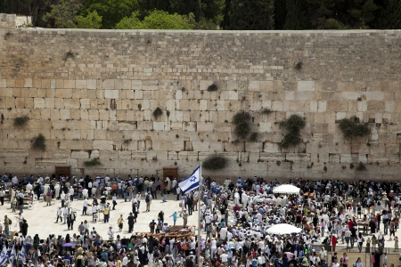 A Thursday morning at the Western Wall, one of the most sacred places to the Jewish religion. The  place is filled with Bar-Mitzvah boys and their families, practicing the ceremony of putting on phylacteries, two days before they are called up to read fro