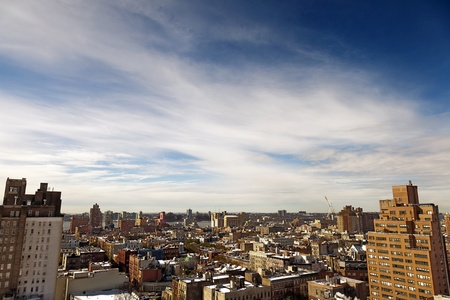 High angle view to the west at the snow covered rooftops of the West Village in Manhattan, on a lovely sunny day. photo