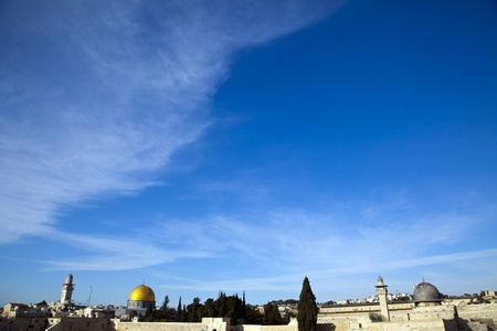 A view of the Temple Mount in the old city of Jerusalem, onlooking The Dome of the Rock and Al-Aqsa mosque, as well as a small part of the Jewish Wailing Wall. photo