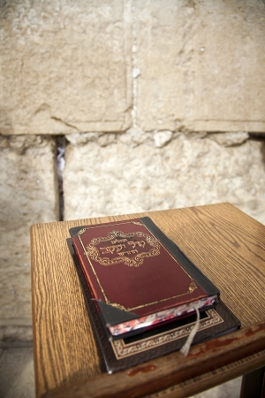 The biblical book of psalms resting on a pedistal in front of the wailing wall in the old city of Jerusalem, Israel.