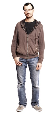 tiresome: An adult caucasian man at his early 30s wearing casual sneakers, a pair of blue jeans and a hoodie over a black t-shirt. Hes looking at the camera with a serious and somewhat tiresome gaze. Isolated on white background. Stock Photo