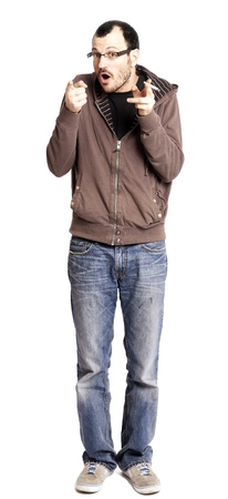 early 30s: An adult caucasian man in his early 30s wearing casual sneakers, a pair of blue jeans and a hoodie over a black t-shirt, and holding a rolled cigarettejoint in his hand. Hes looking at the camera with a cheerful expression, as if in the middle of singi Stock Photo