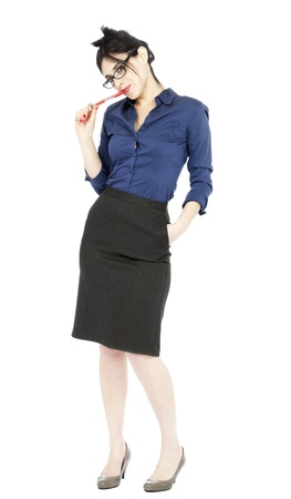 early 30s: An adult (early 30s) black haired caucasian woman, wearing a blue buttoned shirt, a dark gray skirt and holding a pen in her mouth, and looking at the camera with an alluring gaze assisted by her sensual posture. Isolated on white background.